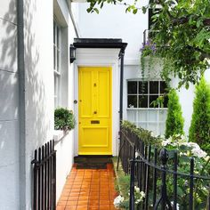 The Doors of London is an ongoing project by British photographer Bella Foxwell. She travels around London, taking pictures, as the name suggests, of peoples' front doors and her photos look like something straight out of a fairy tale. Yellow Front Doors, Front Door Paint Colors, Painted Front Doors, Colored Front Doors, Colored Door, The Doors, Entry Doors, Welcome Signs Front Door, Beautiful Front Doors