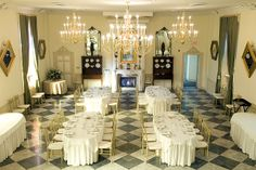 Renaissance Event Venue - The Upper Salon presents an elegant event space with seating for up to 200 guests. Architectural features include a 20 foot ceiling, marble floors, 8 stained glass windows, a gas fireplace focal point, 5 antique chandeliers and a decorative balcony overlooking the salon.