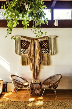 This giant macramé wall hanging, one of two in the house, was sourced from a textile maker in New Mexico. (Photo: Jeremy Liebman)