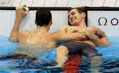 South Africa's Cameron van der Burgh is congratulated by Australia's Christian Sprenger after his gold medal win in the men's 100-meter breaststroke swimming final at the Aquatics Centre in the Olympic Park during the 2012 Summer Olympics in London, Sunday, July 29, 2012. Photo: AP / AP