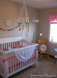 Baby girl nursery -- I love the top of this mobile
