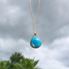 The sun peeked out long enough for me to get a pic of this morenci turquoise & gold necklace on this cloudy #turquoisetuesday.   #bluestblue #morenci #turquoiseandgold #handmade #summerlovejewelry