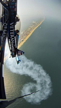 Pilot Rob Holland of Nashua, NH, maneuvers his MX2 plane over Ocean City more than 3,000 feet above the Atlantic Ocean, the day before the 2011 OC Air Show. The picture was taken with a GoPro Digital camera mounted to the wing tip of the plane. The palm sized camera was programmed to...