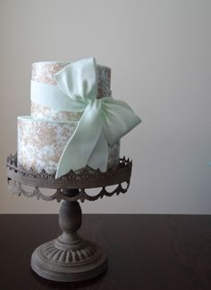 Toile wafer paper wrapped over pale aqua fondant.