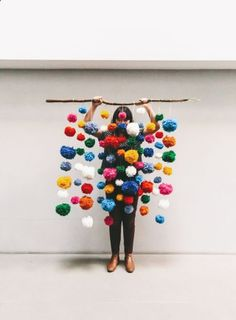 DIY inspo: pompom garland. I really like how they are hanging from a branch.