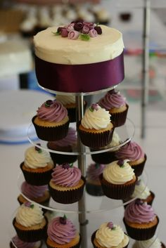I don't care for this dark color, but this is a nice setup with the cake on top and cupcakes around that coordinate. Bride Cupcakes, Wedding Cupcakes, Wedding Cake, Plum Wedding, Wedding Fun, Floral Wedding, Wedding Colors, Wedding Stuff, Wedding Ideas