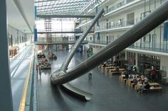 Discover Parabolic Slides in Garching bei München, Germany: Four-story slides send people whizzing through the math department at this Munich university. Indoor Slides, Technical University, Interesting Buildings, Munich Germany, Green Building, School Design, Art And Architecture, Places To See, Around The Worlds