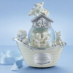 Noah's Ark Water Globe, $59.99: A delightful water globe that tastefully mixes white bisque with silver touches for a gift her baby will want to keep for a lifetime. Just engrave it with his or her name and birth date! Two by two, the animals - giraffes, elephants, lions, zebras, monkeys, lambs and more - set sail.