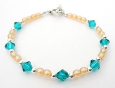 A simple bracelet with Blue Zircon Swarovski crystals and traditional Peach Czech beads with silver spacers.