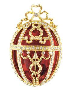 """RED ROSEBUD FABERGÉ EGG, 2.5""""H, CRYSTAL, $95; HORCHOW: 877-944-9888; HORCHOW.COM."""