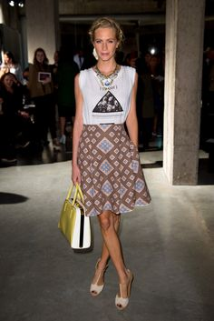 Poppy Delevingne got playful in a casual t-shirt and a printed full skirt at the Jonathan Saunders show.