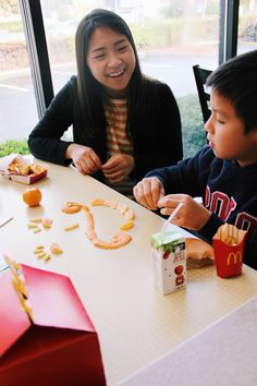 Making silly food faces with french fries and Cuties ®, now included in @Mcdonalds Happy Meals ®! (Ad)
