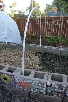 Cinder block raised beds and hoop house tutorial. I would also use this to make a cool play house & use a sheet for the cover for shade.