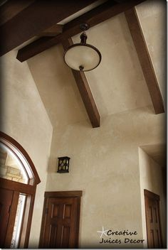 Rustic Tuscan entry - home tour  Old world with american clay and wood beams