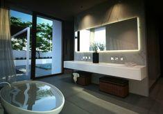 Simple and elegant bathroom. Use of polished cement floors - fantastic. Illuminated lighting behind the mirror - perfect. #bathroom