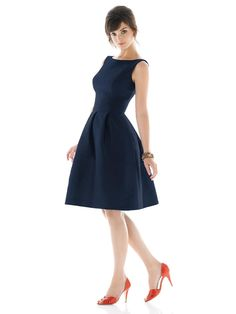 A cocktail length Alfred Sung bridesmaid dress with bateau neckline and scoop back. Style D448 has a pleated A-line skirt with pockets at side seams and a wide set-in waistband. Made from Dupioni. Hidden zipper in back.