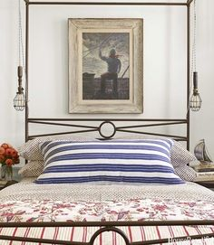 notice the cage pendant lights on either side of the bed..