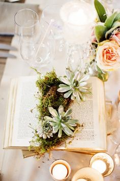 I adore using books as wedding decor - especially when they include moss!