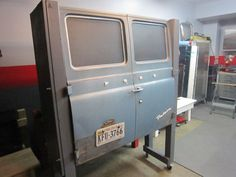 Ford van custom cabinet...would be fun to use VW doors and deck lids for garage cabinets