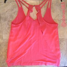 NWT  tank with chiffon ruffles This is a darling NWT Candie's coral tank with chiffon ruffles on the back creating a fun and feminine feel.  pair it with jean shorts or white skinnies for the perfect carefree, but polished look!  comes with an extra gold button. Tops Tank Tops
