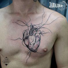 Heart tattoo on breast blackwork by Feeling Good
