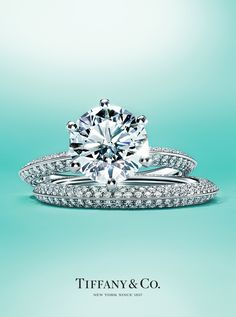 The Pavé Tiffany® Setting engagement ring and Tiffany® Diamond Wedding Band ring in platinum.