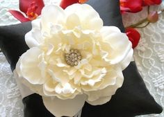 DIY Flower Ring Bearer Pillow - So creative! I would use a nude/light pinkish pillow to compliment my color scheme.