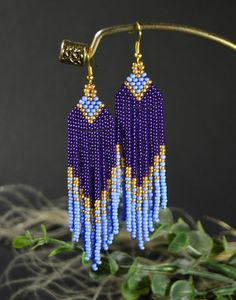 Violet, plum and gold color beaded earrings. Very nice earrings. Made of high quality Czech beads of the luxury class. Own design. Only handmade. Measurements: Length - 3.85 inch Width - 0.78 inch Materials: Seed beads Nylon Thread Please if you have any questions please