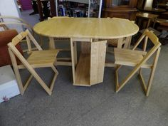Drop leaf table, with cupboard storing 4 foldable chairs ---------------- £55 (pc753)
