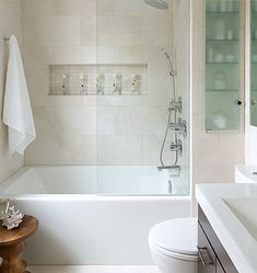 Relaxing Bathroom Designs That Soothe the Soul : Contemporary Bathroom With Beige Tile And White Retangular Tub