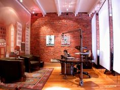 More wood floor and brick wall. Love the white screen partition!