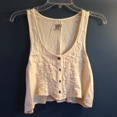 Urban outfitters boho embroidered crop top In like new condition, with no stains, tears, or odors. Adorable cropped tank with embroidered details in front and solid cream in back. Ecote brand by urban outfitters Urban Outfitters Tops Crop Tops