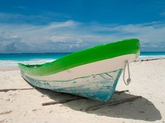 Playa del Carmen, beach  You'll see those colored boats on the amazing white beach everywhere!