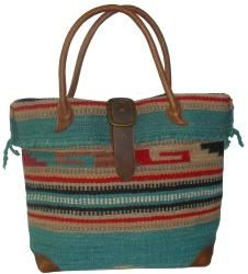 @Overstock - A rugged tribal pattern colors this turquoise wool-blend tote bag from Amerileather. The 'Odyssey' handbag is finished with  brown leather double rolled handles and a belt strap buckle closure.http://www.overstock.com/Clothing-Shoes/Amerileather-Odyssey-Turquoise-Tribal-Print-Wool-blend-Tote-Bag/6201631/product.html?CID=214117 $134.99