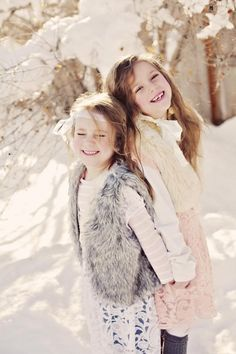 Smiley young ladies in fur vests -