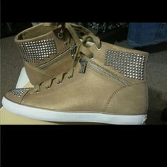 Michael Kors studded sneakers Michael Kors brand new studded hight top suede sneakers  Silver studded with zippers on side  Dark Khaki  Lace up  Rubber sole Michael Kors Shoes Sneakers