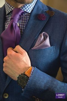 Shop this look for $172:  http://lookastic.com/men/looks/purple-tie-and-blue-double-breasted-blazer-and-white-and-blue-dress-shirt-and-white-and-violet-pocket-square/1729  — Purple Tie  — Blue Double Breasted Blazer  — White and Blue Gingham Dress Shirt  — White and Violet Polka Dot Pocket Square