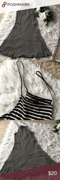 """Brandy Melville Dress Super cute & stretchy. Just too short on me to be a dress (i'm 5'6""""/5'7""""ish). This is a reposh. I've never worn it, the person before me wore it a few times. Feel free to make an offer! Brandy Melville Dresses Mini"""