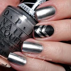 This eye-catching look is easier than it seems. Start with two coats of a chrome silver polish, then use tape to get even lines for the chevrons. #newyears #nails