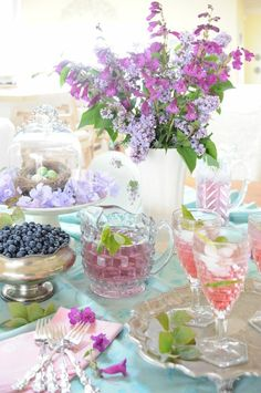 spring flowers with egg nests and pretty beverage glasses and fruit