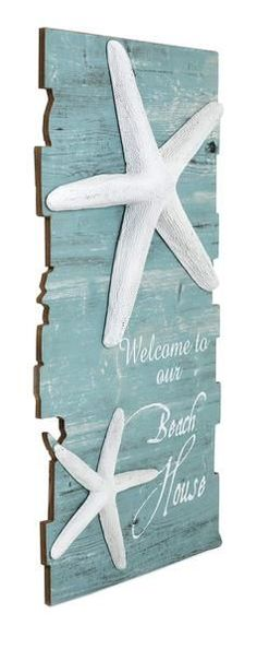 "Make any home your beach house with coastal decor. The ""Welcome to Our Beach House"" sign features a distressed blue finish and dimensional starfish accents. Di"
