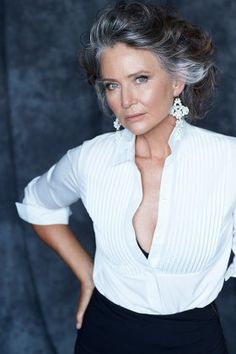 What a beautifully elegant mature woman. Grey and white hair does not make her look old! Far from it.
