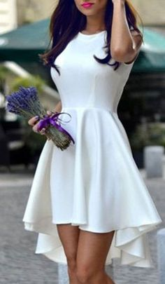 little white dress with a beautifully draped A-line circle skirt and high-low hem. would be a lovely look for an Easter brunch