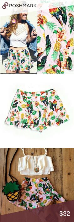 "NWT LF Pink High Waist Parrot Pineapple Shorts Brand new w/ tags. Amazing Hawaiian print. Love. Pink shorts with pineapples, parrots (macaws), & hibiscus flowers & tropical foliage. Ruffle hem. Retailed for $108 at LF. By Rumor Boutique.  *These = Sz S.  Flat waist is just shy of 14"". I'm also selling NWT LF blue skirts in the same print.*   Please check out my closet for more NWT LF items to bundle. LF Shorts"