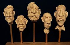 Clay model heads I made that I plan to carve in wood.