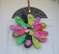 "Flip Flop Watermelon Fun, Decorate your door or room with the summer footwear we love to wear. This wreath is fastened with greening pins making it sturdy and heat resistant. The wreath measures approximately 22"" across, includes 12 flip flops and comes with a variety of flower embellishment's and rhinestones. Please avoid displaying this wreath in between a storm and house door. Too much direct sunlight causes extreme heat built up."