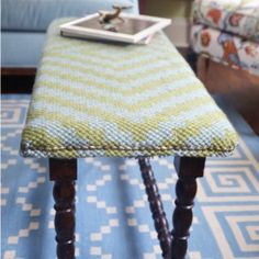 A found bench gets a makeover with an upholstered top from a colorful rug.