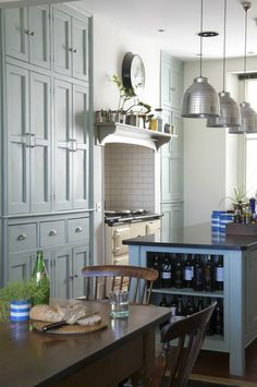 Kitchen Inspiration from House of Turquoise | Light blue kitchen, floor to ceiling cabinets, farmhouse, contemporary