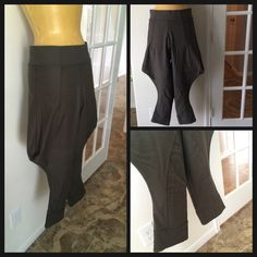 Mangrami  drop crotch jodhpurs Created by Houston based designer. Perfect for the All Saints androgynous goddess! Made from deep olive green thick stretch. Super fun drop crotch strike with jodhpur design and riding pant detailing. Exposed zip back. Super flattering and makes any outfit killer Mangrami Pants Ankle & Cropped