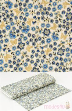 white cotton fabric with gold metallic butterflies and diverse flowers in different shades of blue, with golden accents and outlines, Material: 100% cotton #Cotton #Flower #Leaf #Plants #Insects #Metallic #Butterflies #USAFabrics